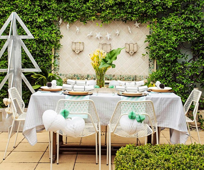 Having a garden gathering? Pull your table theme together by coordinating your cutlery and table linen with your decorations for a stylish setting; then use fresh flowers for a beautiful finishing touch. *Photography: Nick Scott / bauersyndication.com.au*