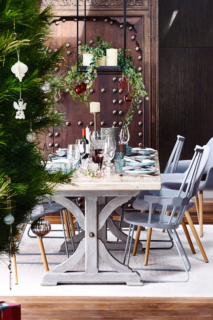 Timber tables and grey furniture makes the perfect setting for lush Christmas greenery so add some hanging holly and sprigs of pine in amongst your place settings for an inviting festive feel. *Photography: Derek Swalwell / bauersyndication.com.au*