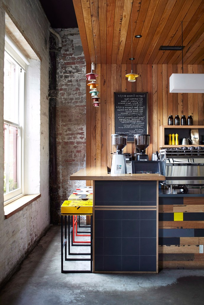 Natural timber warms up this industrial space, while teacup and saucer pendant lights add unique flair. *Photo: Alicia Taylor / bauersyndication.com.au*