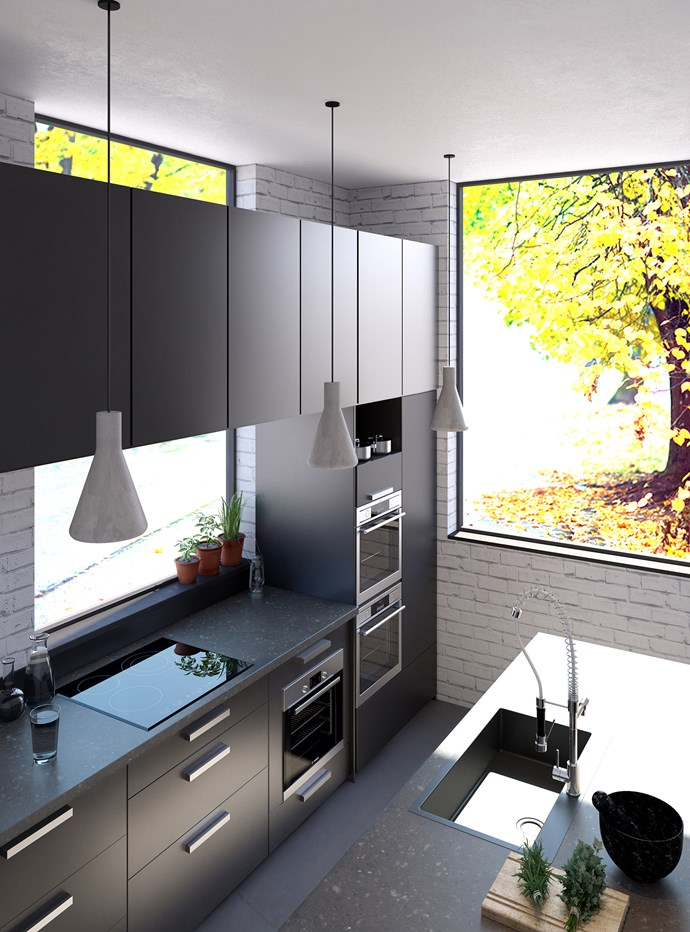 The black kitchen trend was born in NYC and this space takes it a step further by matching dark cabinetry with benchtops featuring [essastone in Bitumen by Laminex](http://essastone.com.au).