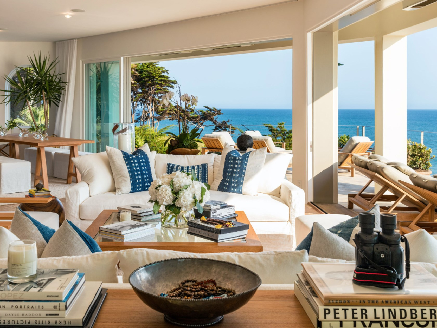 "With floor-to-ceilings windows throughout, the private beachfront home enjoys views of the Pacific Ocean from the openplan Hamptons-style living room. Photo: [Chris Cortazzo Malibu Real Estate](http://www.chriscortazzo.com/|target=""_blank""