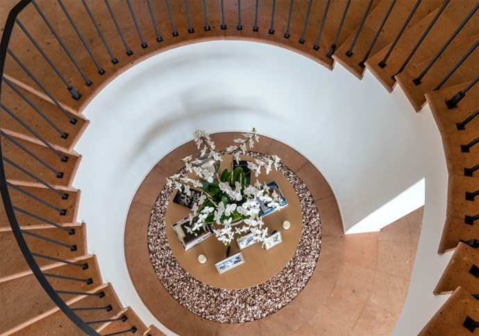 "The circular staircase spirals up to two bedroom suites on the upper level, each with its own private entrance. The second floor is also where you'll find the master bedroom, with amazing ocean views and two separate bathrooms. Photo: [Chris Cortazzo Malibu Real Estate](http://www.chriscortazzo.com/|target=""_blank""