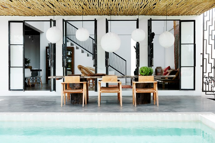 "The streamlined architecture allowed for a melange of different textures and furnishings: bamboo armchairs, large clay pots, hand-dyed decorative netting, colourful textiles, brass lamps and baskets. ""We love the minimal, industrial style of the villa but we have softened the feel and warmed it up with wood furniture and textiles."""