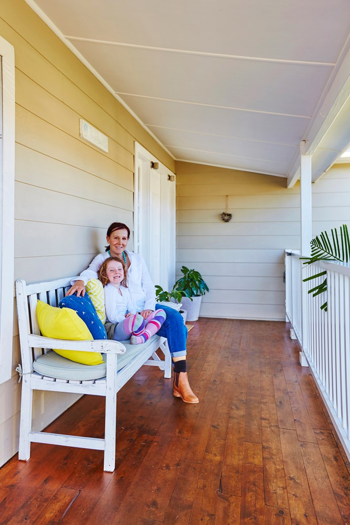 """In the front of the house, we covered the concrete porch in a warm timber to match the back deck and replaced the Greek columns with timber ones that suited our style,"" says Virginia."