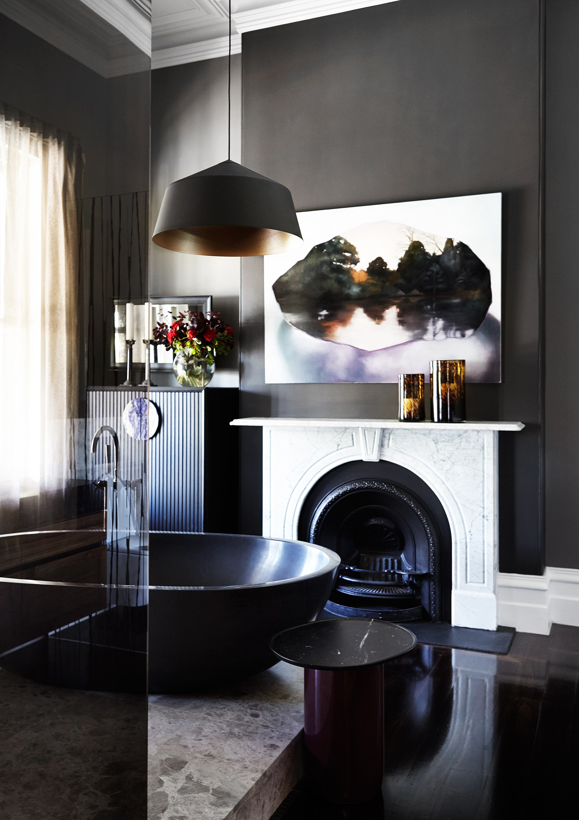 "A stone bath by [Boyd Alternatives](http://www.boydalternatives.com.au/|target=""_blank"") is the ultimate indulgence, adding an earthy feel to this dark and dramatic bathroom within a [historic Brisbane home](http://www.homestolove.com.au/bold-restoration-of-a-heritage-brisbane-landmark-4493