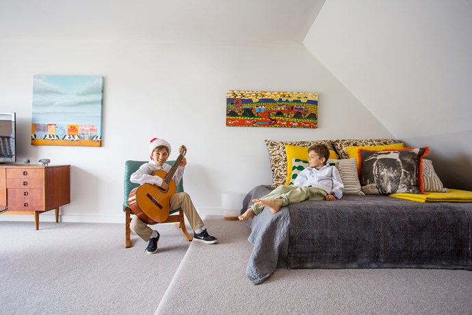 """The large upstairs living room doubles as a [guest bedroom](http://www.homestolove.com.au/7-shortcuts-to-create-the-perfect-guest-bedroom-1729 target=""""_blank"""") and music room for the family."""