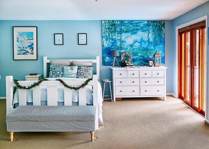 The large print of Monet's waterlilies from Ikea is Steph's favourite. The ottoman doubles as storage.