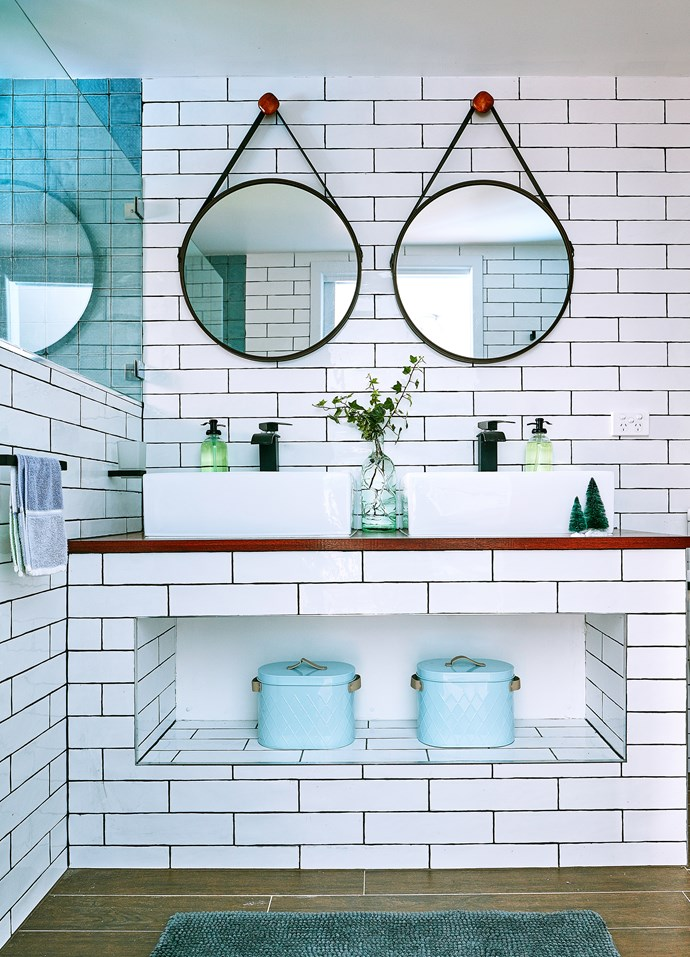 Grey grouting and subway tiles bring a style statement to the ensuite bathroom.