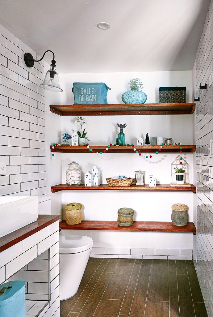 Built-in shelving allows Steph to add a personal touch to the ensuite.