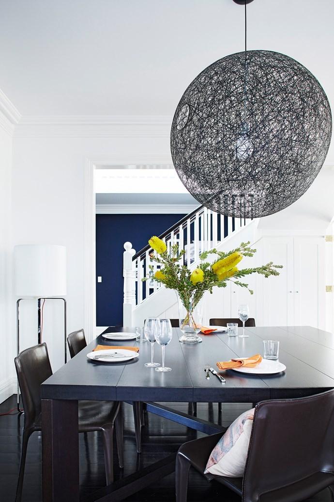 The dark dining setting brings gravitas to the white interior. Designer buy: Moooi Non Random pendant light, from $1015, [Space](http://www.spacefurniture.com.au/).