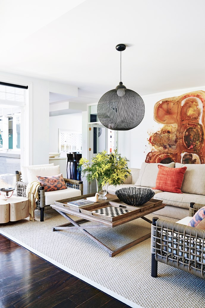 Dramatic contrasts give way to a tonal palette in the living area.