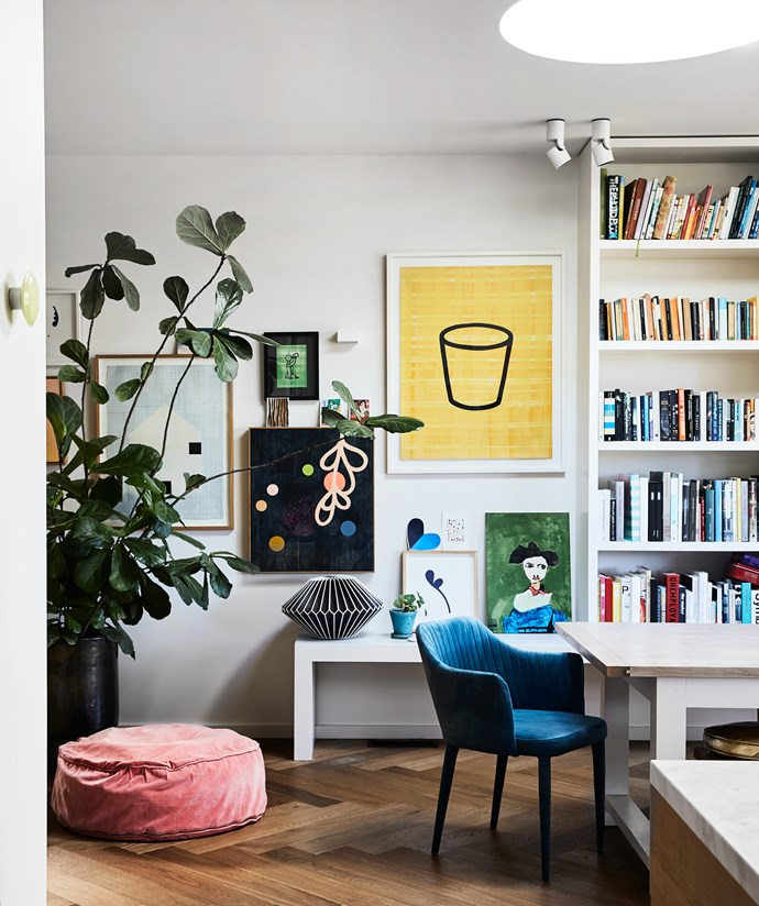 A salon hang of paintings includes prints by David Band (blue house, drinking man and Scotch Schnapps), Little Flora and Navy Flower prints by Rachel Castle and a Paul Hodges tea towel from [Third Drawer Down](https://www.thirddrawerdown.com/). A jumbo pink velvet floor cushion by [Castle](https://www.castleandthings.com.au/) makes for a comfy spot.