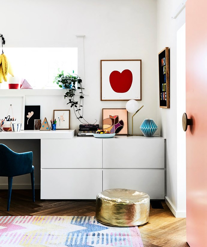 The sliding door separates Rachel's office and the study shared by Daz and Lucas. One side is pink, the other white, and Muuto wall hooks were added as handles.