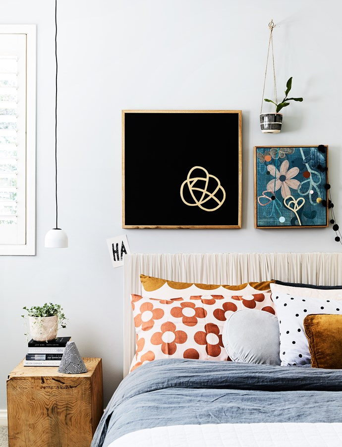 """""""I like my bedroom to be as simple and quiet as possible. I read novels when I can and they're littered everywhere,"""" Rachel says. She made the bedhead by stretching a silk fabric over a canvas."""
