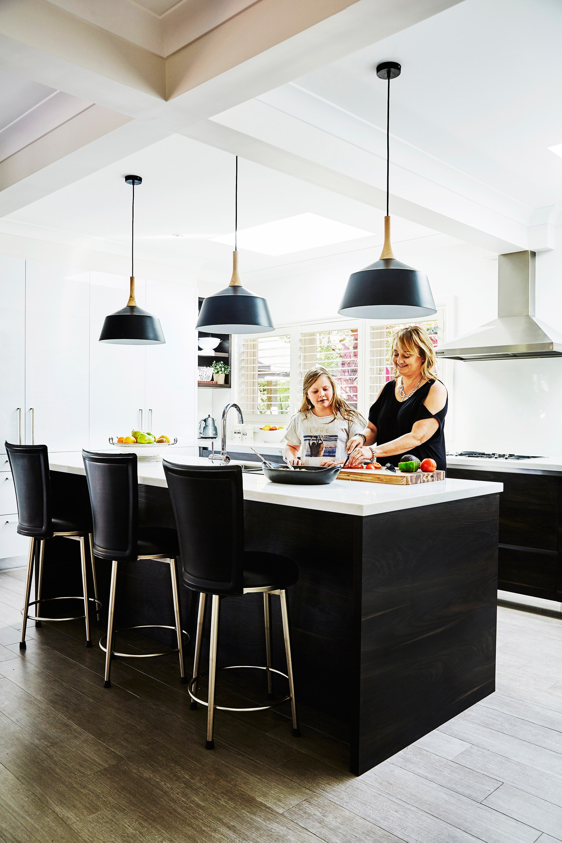 """By knocking down a wall between the kitchen and the formal dining room we created an enormous space for an open-plan kitchen, which provides for practical entertaining because everyone wants to gather around the cook!"" says Nicole."