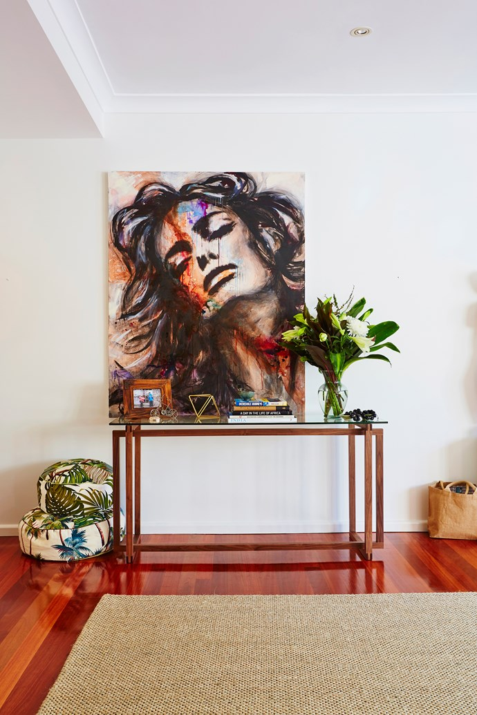 The front entry features a statement art piece by Lisa Brummer above a console table from [Freedom](https://www.freedom.com.au/).