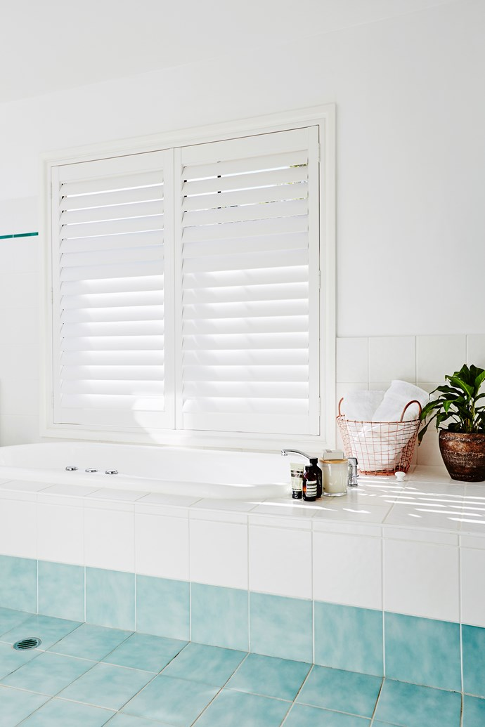 White plantation shutters and aqua tiles are just right for Nicole's resort theme.