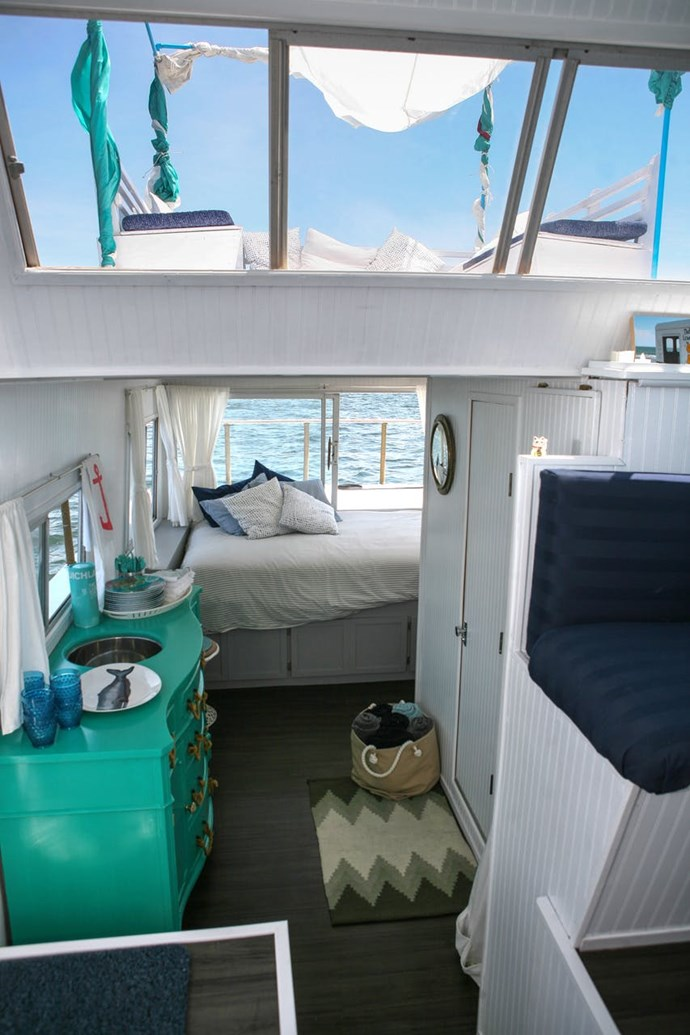 "Photo via [Apartment Therapy](http://www.apartmenttherapy.com/chris-and-kristens-dreamy-houseboat-house-tour-193212#_|target=""_blank""