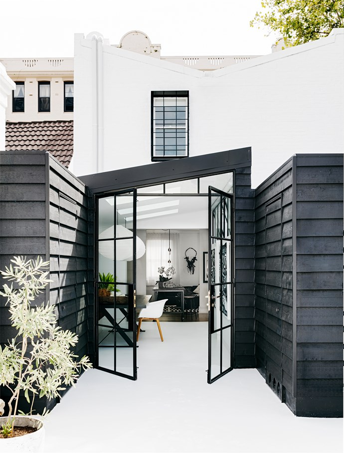 Black steel frame doors connect the interiors to the roof deck.
