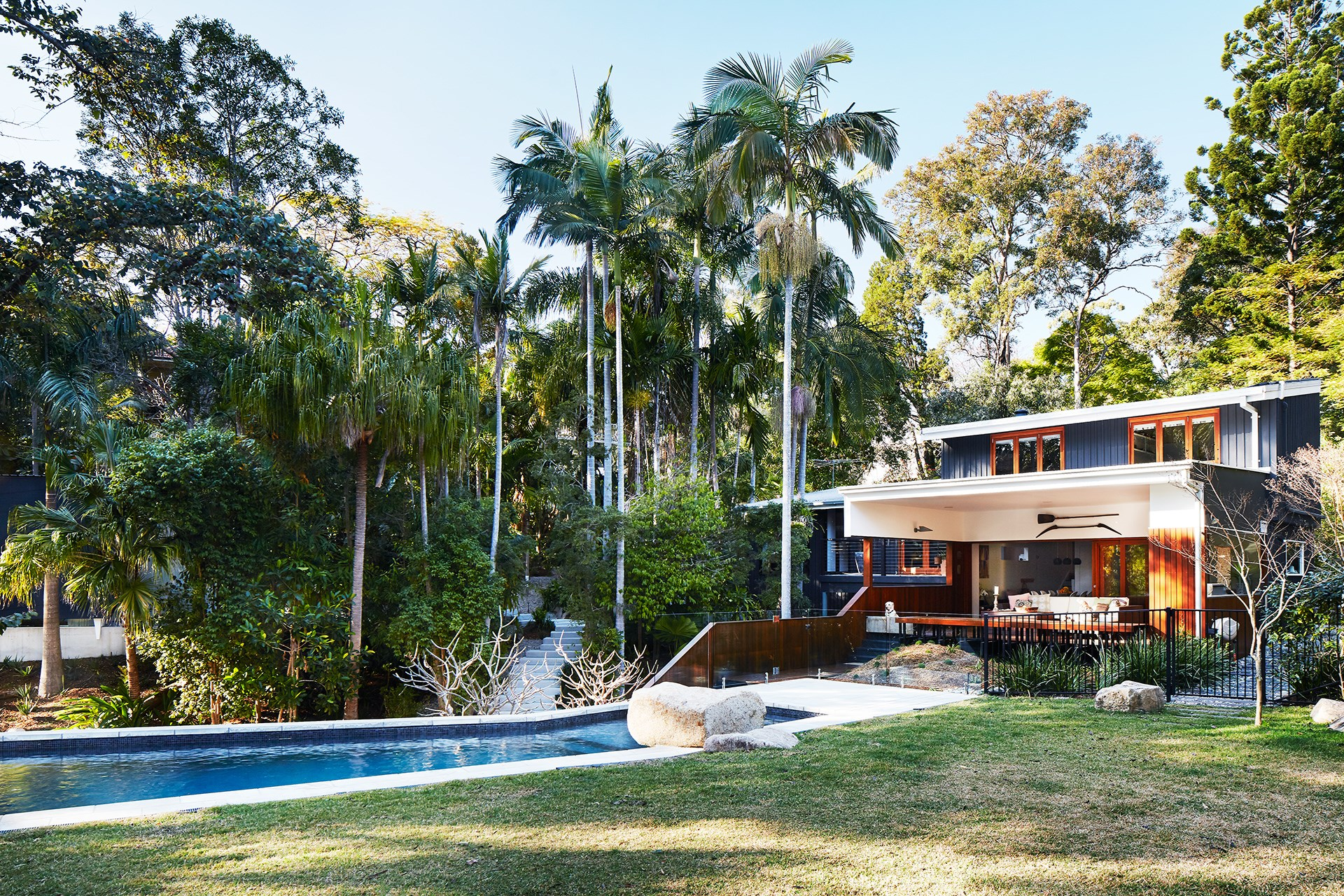 The expansive front yard is a buzzing social space complete with pool,  barbecue area, lawn and sheltered deck. Landscaping by Stephen Clegg Design.