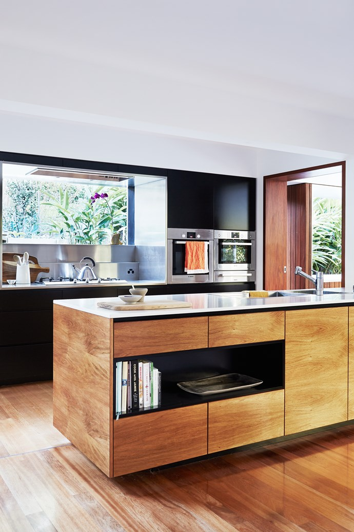 The streamlined kitchen has a few clever hidden features including ceiling speakers and LED lights around the kickboards of the island bench.