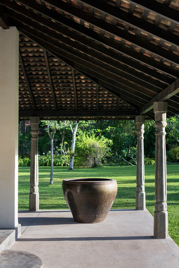 A large Chinese urn bought from Paradise Road Design Warehouse, Colombo, sits on the verandah of the ambalama.