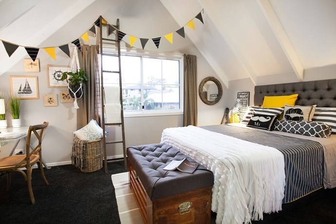 Striped bed linen plus wooden and textural wicker accessories bring the country look to this loft bedroom.