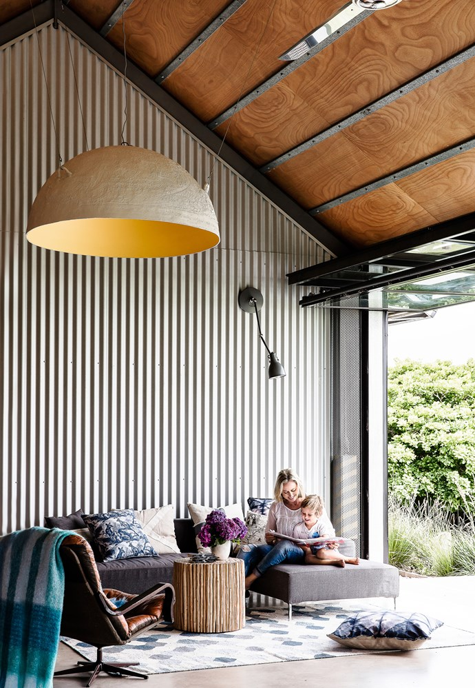 """Alex opted for a hangar door in place of sliding or concertina doors, an unusual feature with added benefits. """"The hangar door allows the room to be completely opened to the outdoors,"""" he says. """"When open, the door acts as an awning as well."""""""