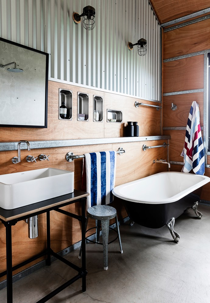 Fibre-cement sheeting is used instead of tiles in the shower area of both bathrooms.