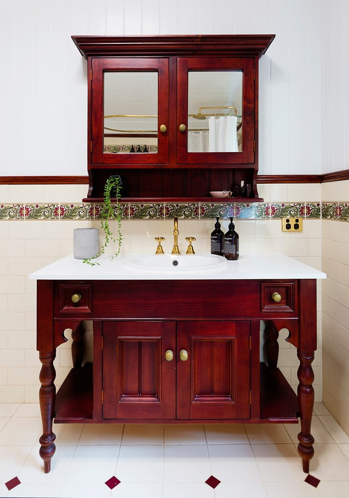 The original bathroom vanity was refurbished with a new stone top, sink and tapware, and the timber and brass polished up.