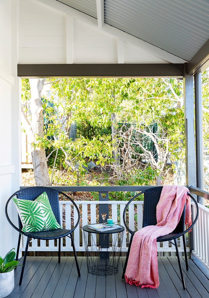 Dark outdoor furniture makes updating with accessories easy and affordable.