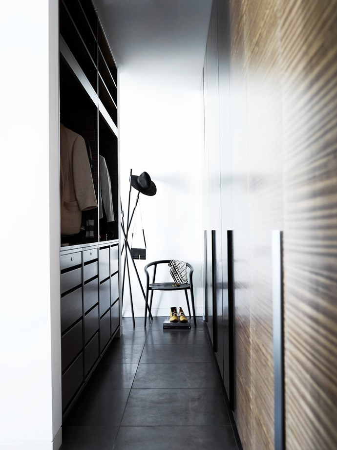 A Ligne Roset 'Modified' coat stand from Domo stands in the hallway that leads to the bedroom.