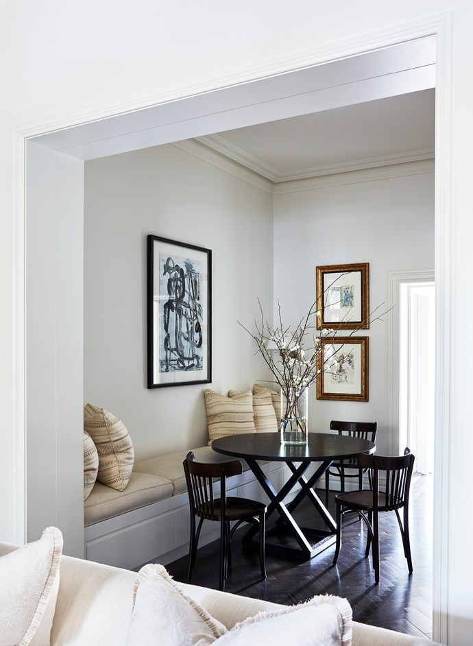 Thonet chairs and a painting by Olivier Rasir add a contemporary touch to the dining room.