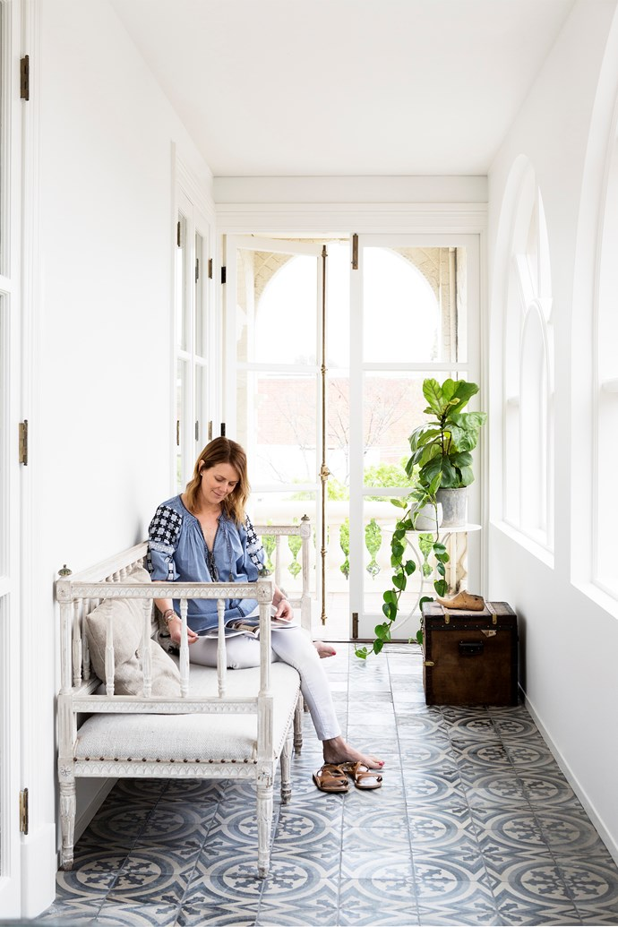 """Susanne relaxes on a reupholstered antique Swedish bench, brought back from London, in this light-filled space. Designer buy: Chateau antique encaustic tiles, $425/m2, [Jatana Interiors](http://www.jatanainteriors.com.au/