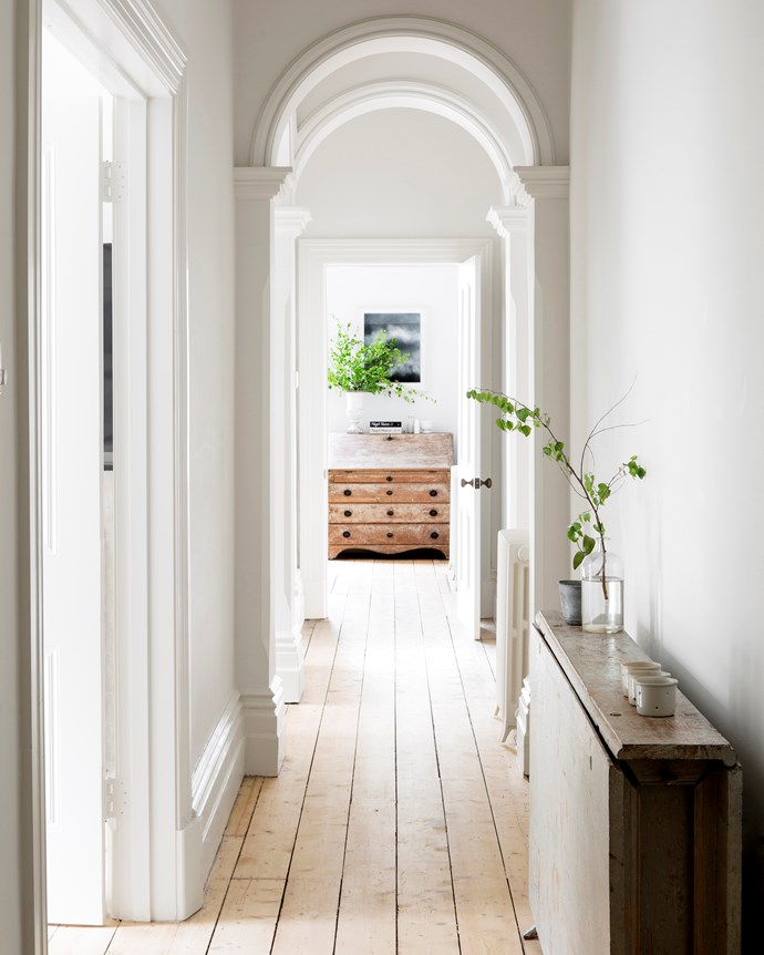 An arresting line of sight leads the eye past a progression of archways to the kitchen.
