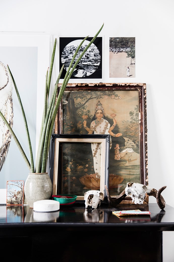 A beautifully composed tablescape on Richard's desk reveals a world of cultural influences. Flowers and foliage throughout from Mandalay Flowers.