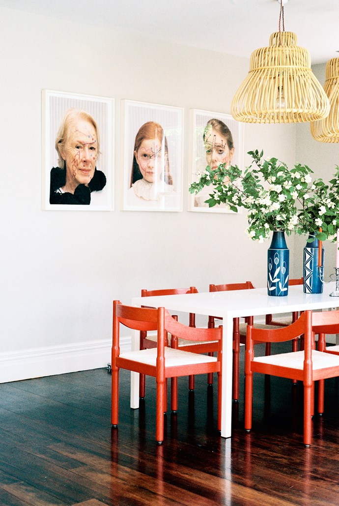 The artwork on the dining room wall is a collaboration between photographer Deborah Smith and artist John Reynolds, who painted over the faces. The red Carimite dining chairs, designed by Vico Magistretti, were purchased from DePadova in Italy. The lightshades are by Vittorio Bonacina and the vases were bought from Art & Industry Antiques in Auckland.