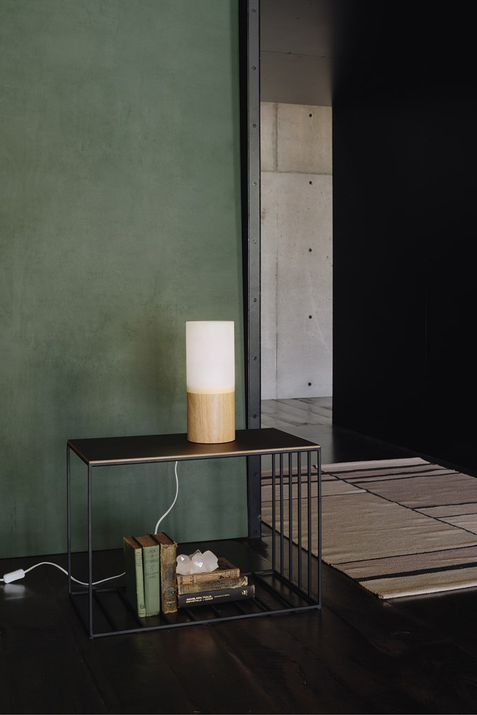 Linear grid sofa table, $660. Ombre table lamp, $299. Rayas hand woven cotton rug, from $199.