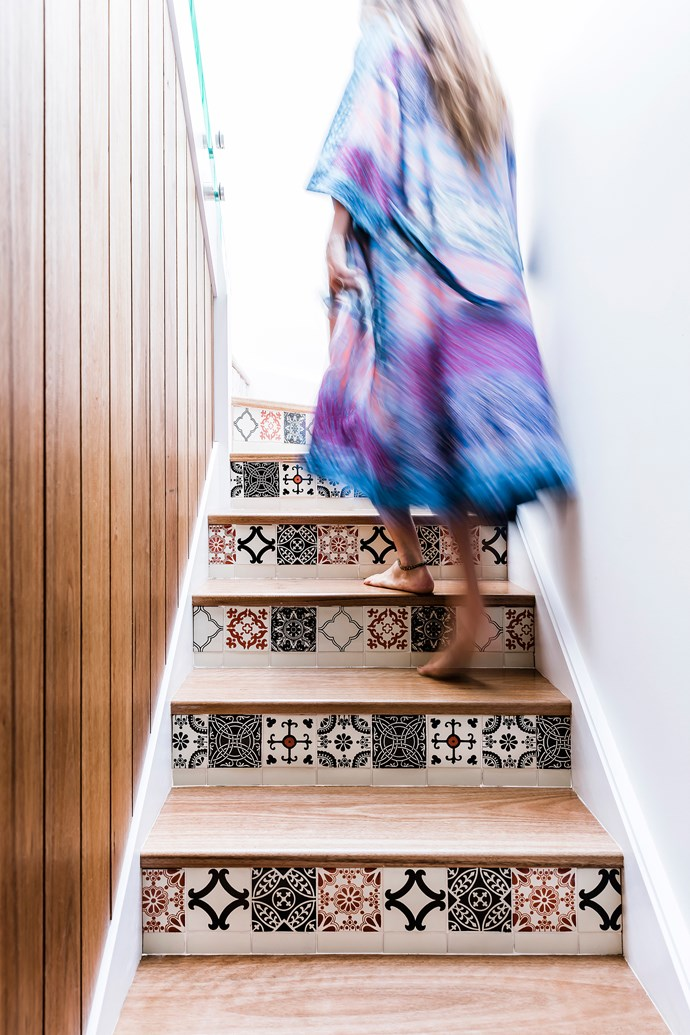 Patterned tiles are a great way to bring a narrow staircase to life.