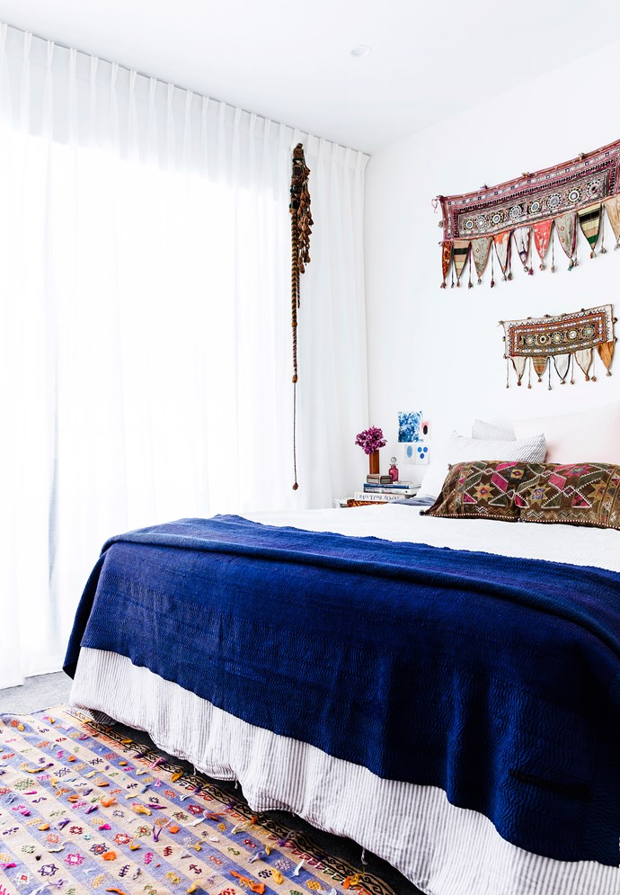 Amelia has brought together gorgeous textiles in her bedroom. The bedlinen is from In Bed, the blue throw was found on a trip to Delihi, India, and the wall hanging is from Gujarat. The hanging ornament is a camel decoration, also from Morocco, and the rug is from Cadrys.