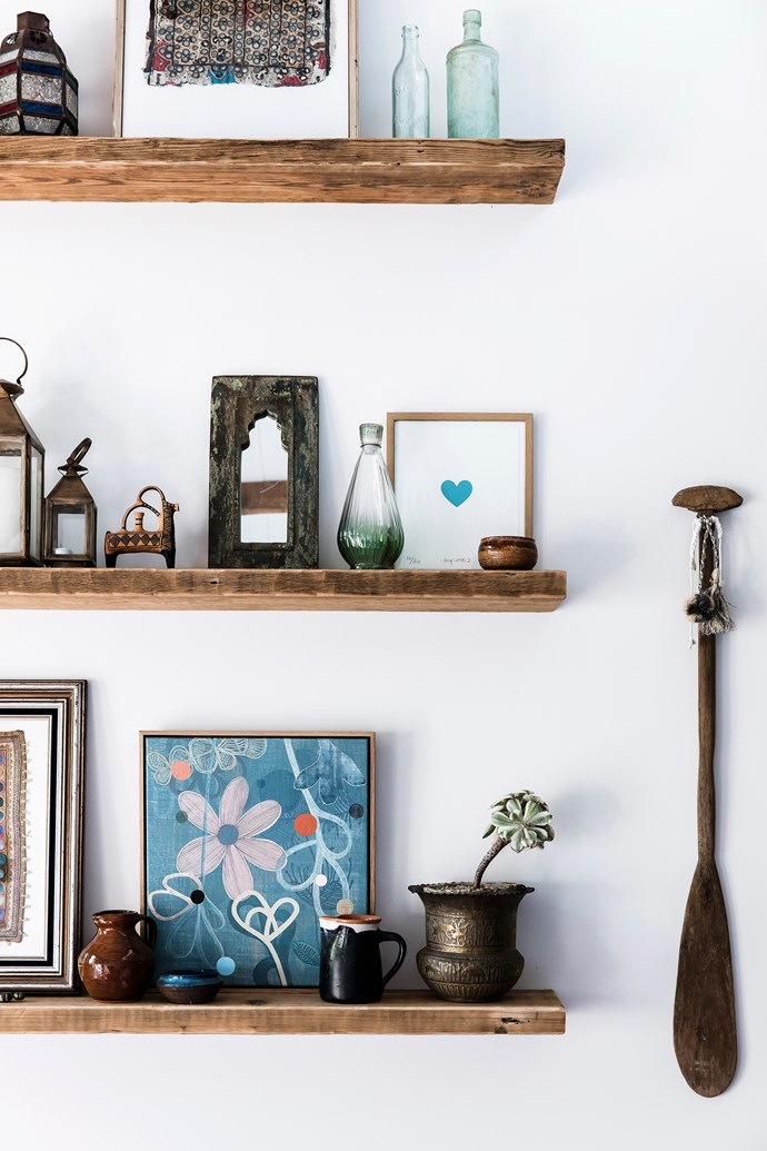 """Shelving created from recycled Oregon timber is lined with a display of Amelia's travel finds, including pottery from Greece and family heirlooms. The painting of flowers is by [Rachel Castle](http://www.homestolove.com.au/rachel-castles-colourful-and-quirky-sydney-home-4729