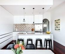 white kitchen with colourful splashback