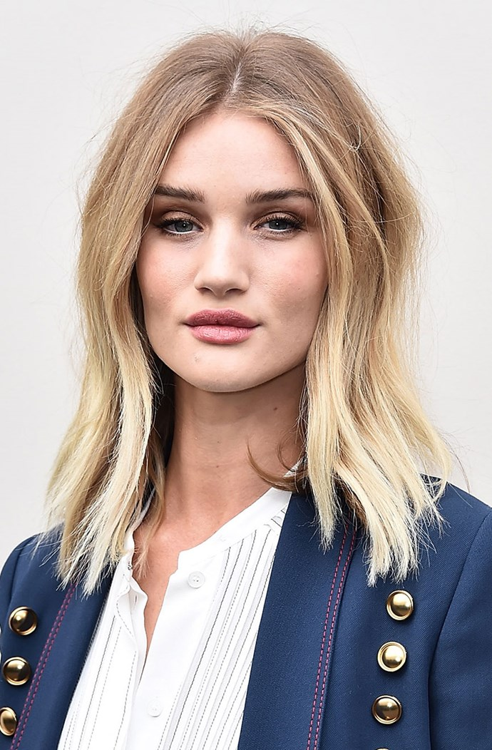 """**ALSO TRY... THE STRAIGHT-UP:** Dishevelled and less structured than the first, Ward recommends using a medium tong, taking small sections and loosely wrapping around the tong. """"Once you've finished the whole head, flip upside down and brush your fingers through. Finish with a styling spray."""