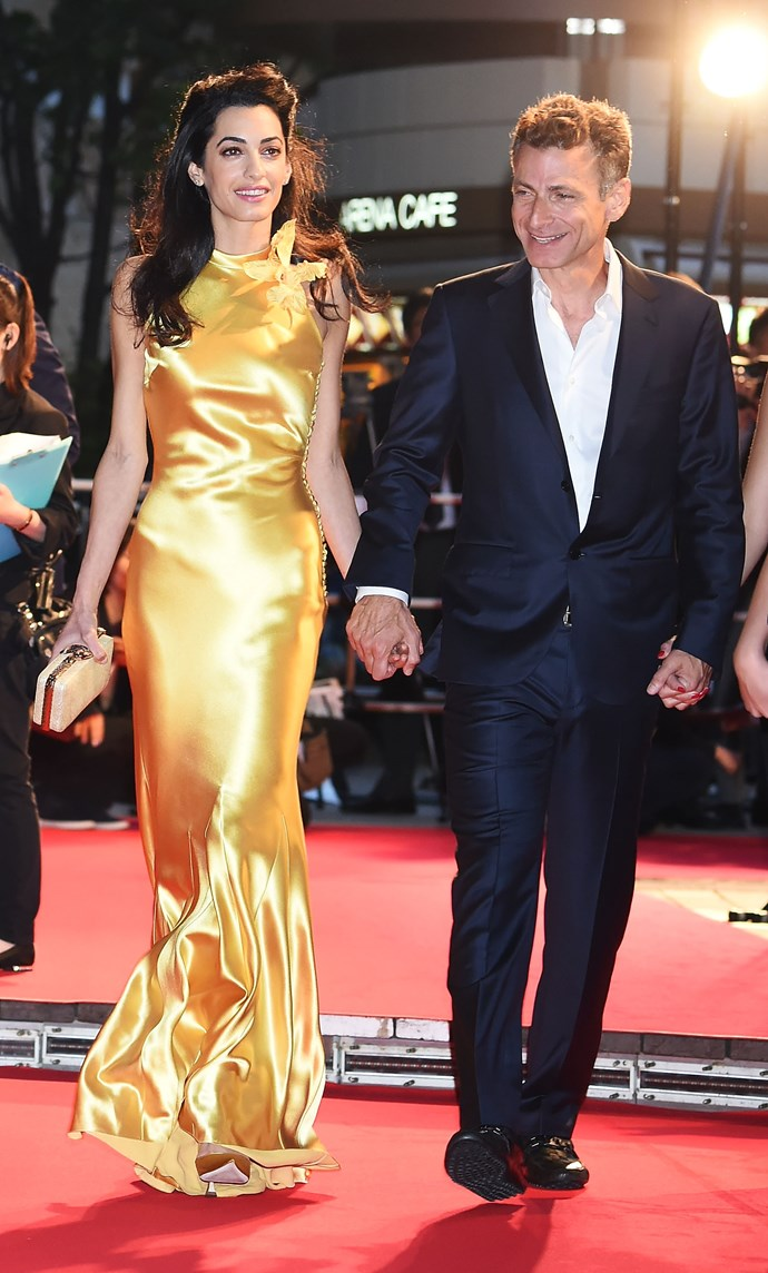 She doesn't even need to wear yellow to outshine George but, at the Japan *Tomorrowland* premiere in May of 2015, she did just that. Hang on a minute, who's that bloke?!