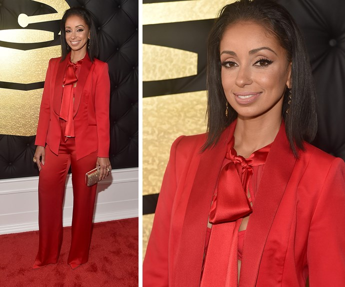Mya's red pantsuit has a sexy twist with a bralet underneath.