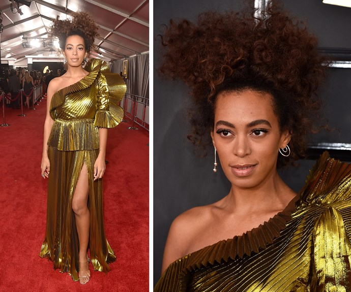 Solange is a ray of sunshine in this pleated golden gown.