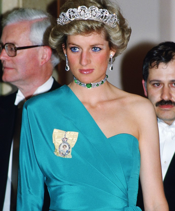 "[Princess Diana](http://www.nowtolove.com.au/royals/british-royal-family/princess-diana-to-be-honoured-on-national-kindness-day-35364|target=""_blank"") stuns in an emerald green dress, matching bejewelled choker and the Spencer diamond tiara at a banquet at Claridges in 1988."