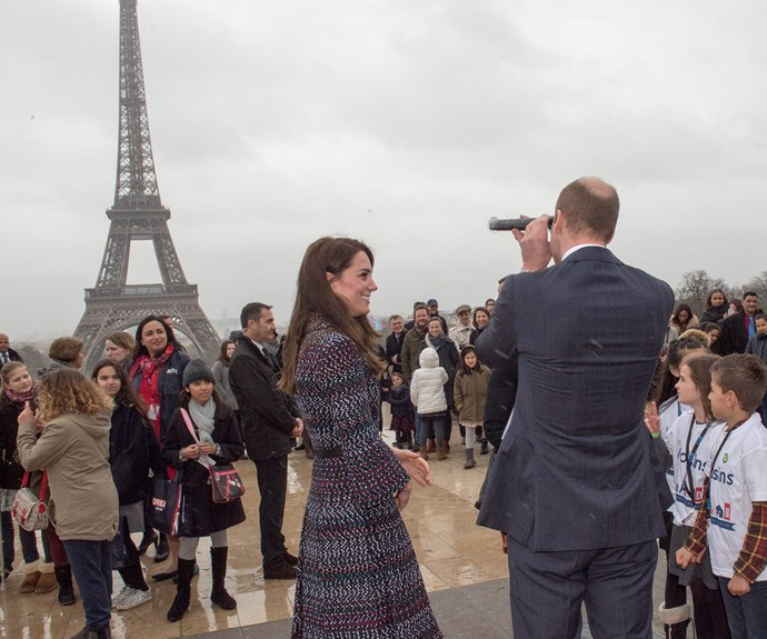 While the couple's two children - Prince George, three, and Princess Charlotte, one - didn't join their parents, William still showed off his dad side when he decided he needed extra help checking out the Eiffel Tower.