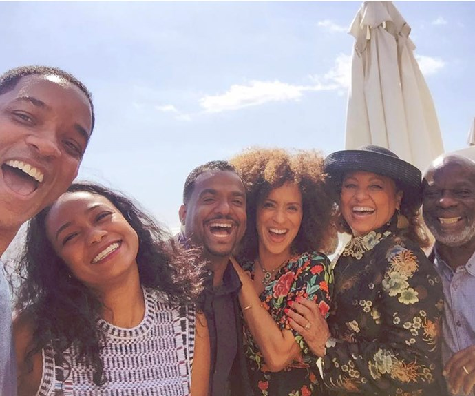 """Will Smith took to Facebook to share a snapshot from his lunch with *The Fresh Prince of Bel-Air* gang, penning, """"Lunch with my BFF's... I missed my Uncle Phil today."""" The catch-up included Alfonso Ribeiro [Carlton Banks ], his on-screen sisters Tatyana Ali and Karyn Parsons [Ashley and Hilary Banks], along with Daphne Maxwell Reid [Aunt Viv] and Joseph Marcell [everyone's favorite butler Geoffrey]. There was one notable absence with James Avery, who played Uncle Phil."""