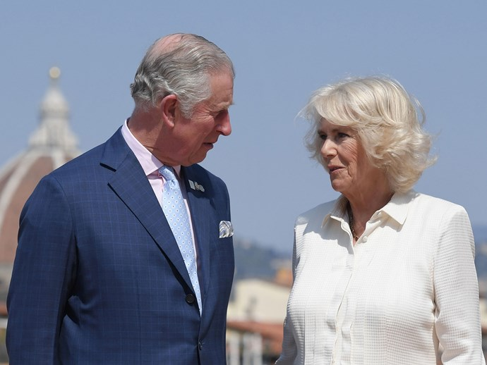 Charles and his darling wife Camilla share a look of love on the terrace of the Palazzo Pitti in Florence, Italy.